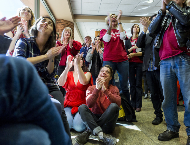 Dozens of individuals cheer as they watch testimonies given against  the proposed development of 5,025 homes on Blue Diamond Hill to the County Commissioners Wednesday, Feb. 22, 2017, at the Clark ...