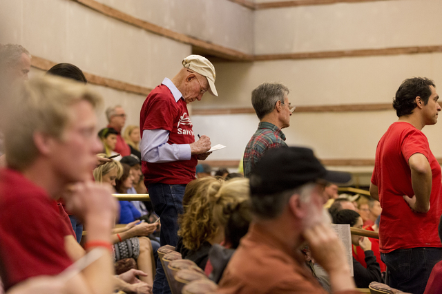 Howard Booth, 90, center, has been fighting for Red Rock for  55 years, goes over his testimony that he will give against the proposed development of 5,025 homes on Blue Diamond Hill to the County ...