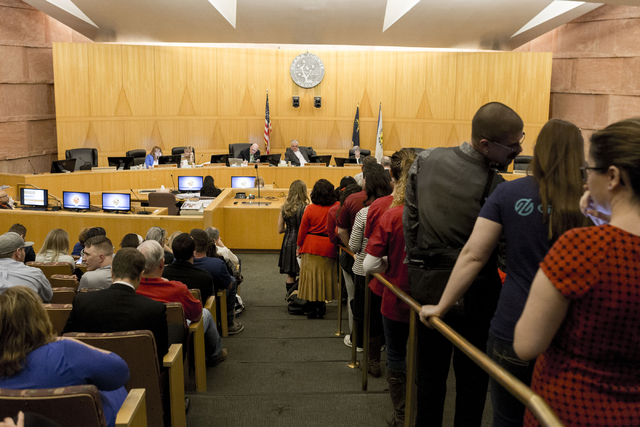 Dozens of individuals line up to give their testimony regarding the proposed development of 5,025 homes on Blue Diamond Hill to the County Commissioners Wednesday, Feb. 22, 2017, at the Clark Coun ...