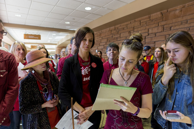 Rebecca Kickel, supporter of Save Red Rock, sings up to give a testimony against  the proposed development of 5,025 homes on Blue Diamond Hill to the County Commissioners Wednesday, Feb. 22, 2017, ...