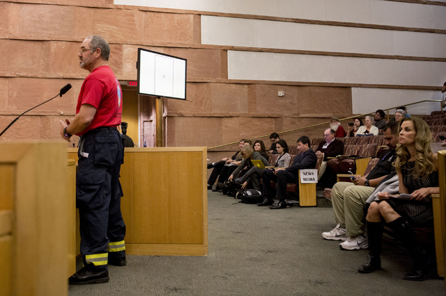 Kevin McGinn, deputy chief of the Blue Diamond Hill volunteer fire station, gives a testimony against  the proposed development of 5,025 homes on Blue Diamond Hill to the County Commissioners Wedn ...