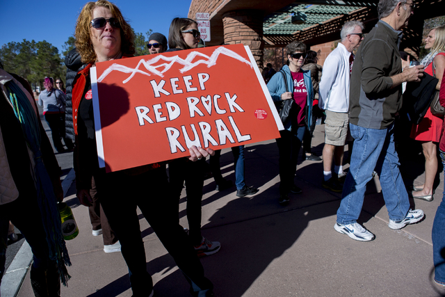 Susan Nicaise a supporter of Save Red Rock, holds a sign to protest the proposed development of 5,025 homes on Blue Diamond Hill at a press conference before the County Commissioners meeting Wedne ...