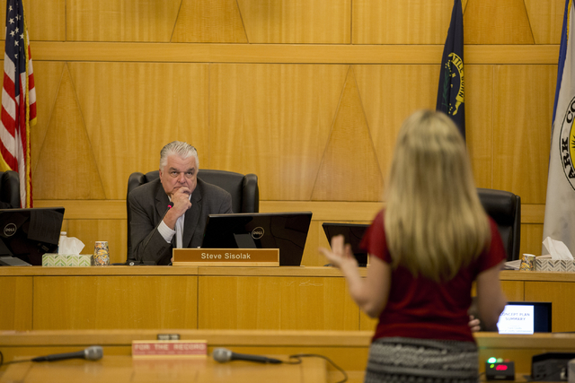 Steve Sisolak, County Commissioner chairman, listens to Heather Fisher, president of Save Red Rock, testify against the potential Blue Diamond Hill development, Wednesday, Feb. 22, 2017 at the Cla ...