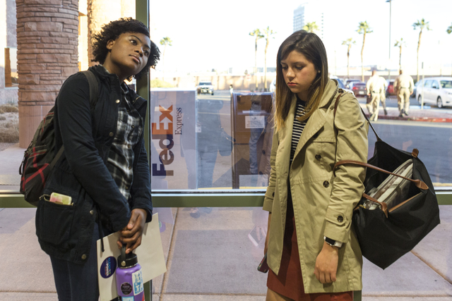 Naomi Lewis, conservation organizer for Nevada Conservation Legue, left, and Demi Falcon, supporter of Save Red Rock leave the County Commissioners planning meeting with low spirits after the deci ...