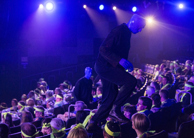 Blue Man Group member Mathew Banks, right, climbs over guest during the show on Tuesday, Jan. 31, 2017, at the Luxor hotel-casino, in Las Vegas. (Benjamin Hager/Las Vegas Review-Journal) @benjamin ...