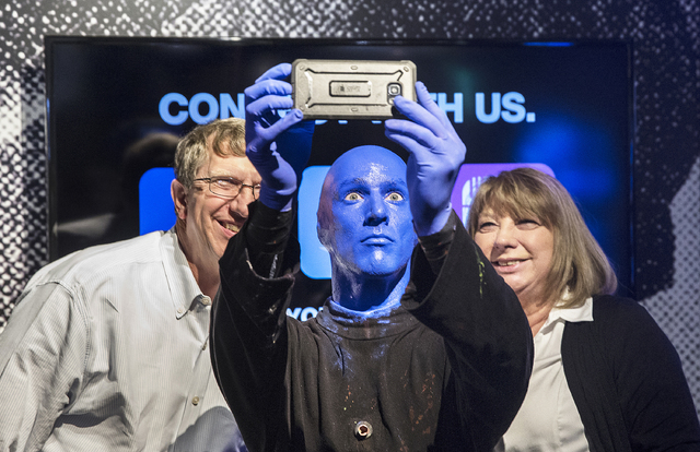 Alain Rochefort, captain of the Blue Man Group Las Vegas, takes a photo with Joel and Jan Owen after the show on Tuesday, Jan. 31, 2017, at the Luxor hotel-casino, in Las Vegas. (Benjamin Hager/La ...