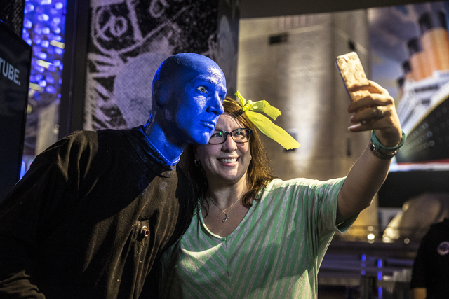 Alain Rochefort, captain of the Blue Man Group Las Vegas, takes a photo with Jessica Jones after the show on Tuesday, Jan. 31, 2017, at the Luxor hotel-casino, in Las Vegas. (Benjamin Hager/Las Ve ...