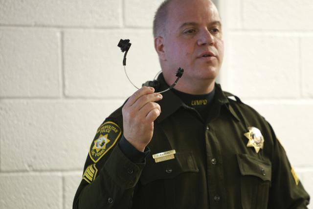 Las Vegas police Sgt. Peter Ferranti demonstrates the department's body cameras during a media presentation at the Mojave Training Center in Las Vegas Wednesday, Nov. 12, 2014. (Erik Verduzco/Las  ...