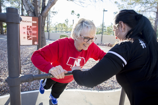 Carolyn Bruce, left, a baby boomer living at the Mountain Shadows Community Center, and Lara Ceccarini, personal trainer, partake in their workout agenda outside of the community's Fitness Center  ...
