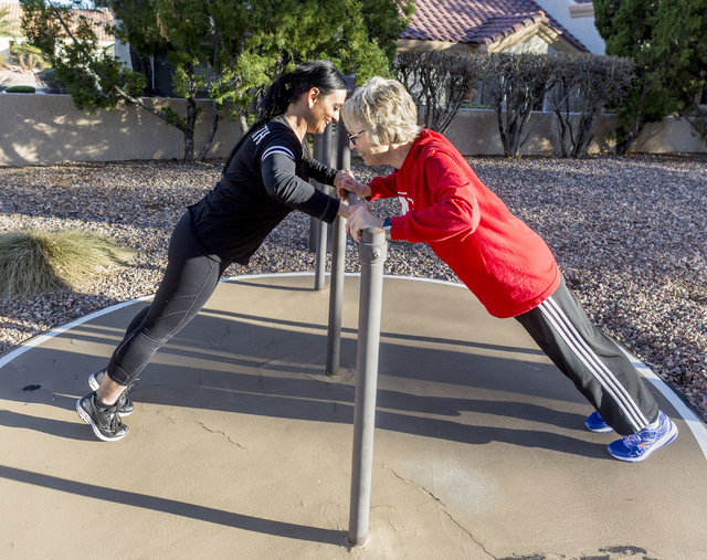 Lara Ceccarini, left, personal trainer, and Carolyn Bruce, a baby boomer living at the Mountain Shadows Community Center, works on strength building exercises outside of the community's Fitness Ce ...