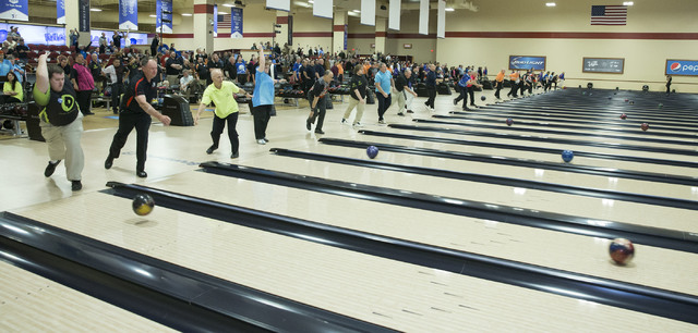 Bowlers on the opening squad warm up on Saturday, Feb. 18, 2017, at South Point hotel-casino, in Las Vegas. An estimated 50,000 bowlers from around the world will compete over the next five months ...