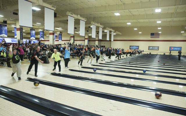 Bowlers participate in the mass ball shot signifying the start of the U.S. Bowling Congress Open Championships on Saturday, Feb. 18, 2017, at South Point hotel-casino, in Las Vegas. An estimated 5 ...