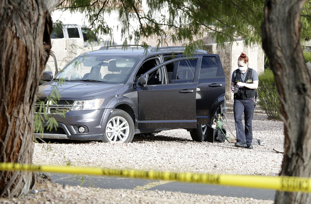 A crime scene investigator prepares to dust a vehicle for fingerprints after a man fled after trying to steal an ATM from a Walgreens at 401 N. Arroyo Grande Blvd. in Henderson on Tuesday, Feb. 7, ...
