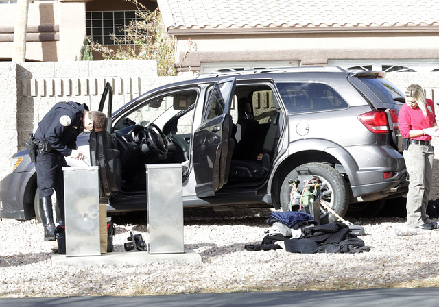 A Henderson police officer investigates a vehicle after a man fled after trying to steal an ATM from a Walgreens at 401 N. Arroyo Grande Blvd. in Henderson on Tuesday, Feb. 7, 2017, in Henderson.  ...