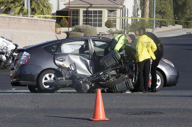 Henderson police investigate a fatal crash involving a motorcycle and car at Sun City Anthem Drive and Thunder Bay Avenue in Henderson on Dec. 6, 2016. (Bizuayehu Tesfaye/Las Vegas Review-Journal) ...