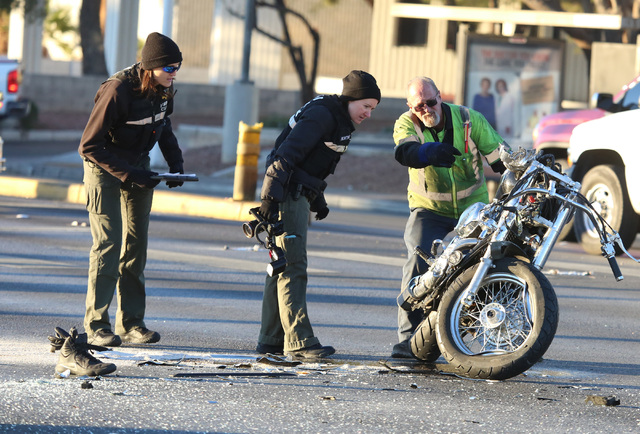 Las Vegas police investigate a crash involving a motorcycle near South Maryland Parkway and East Vegas Valley Drive on Dec. 20, 2016. A motorcyclist was taken to the hospital with critical injurie ...