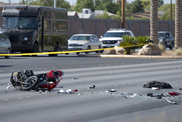 A critical-injury crash involving a motorcycle and a four-door vehicle shut down traffic in the intersection of Washington Avenue and Martin Luther King Boulevard in Las Vegas on June 22, 2016. (B ...