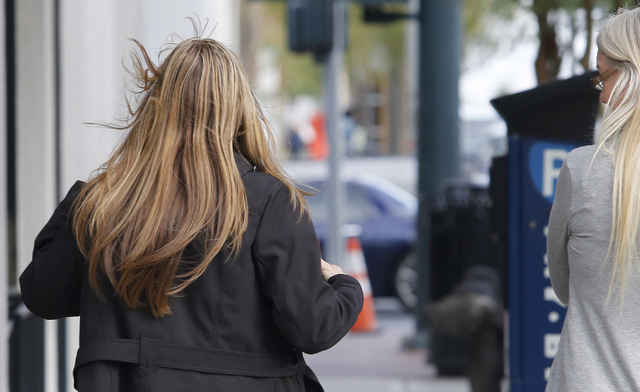 A gust of wind blows a lady's hair as she crosses the street on Tuesday, Feb. 7, 2017, in Las Vegas. A wind advisory is in effect until 10 p.m.  (Christian K. Lee/Las Vegas Review-Journal) @chrisk ...