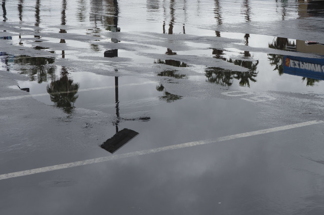 Puddles fill a parking lot on Saturday, Feb. 18, 2017, in downtown Las Vegas. On Friday a flash-flood watch for Southern Nevada that will last through Saturday evening was issued by weather servic ...