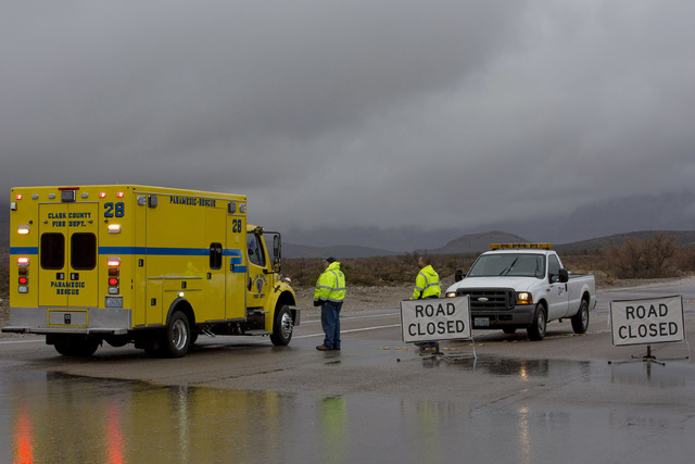 A portion of Blue Diamond Rd, leading to Red Rock Canyon's scenic loop, was closed due to flooding Saturday, Feb. 18, 2017, in Las Vegas. On Friday a flash-flood watch for Southern Nevada that wil ...