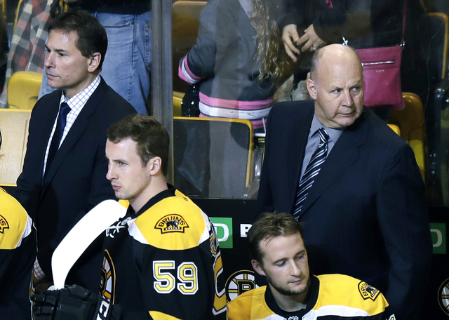In this Jan. 24, 2017 file photo, Boston Bruins head coach Claude Julien, right, stands with assistant head coach Bruce Cassidy, left, during the first period of an NHL hockey game in Boston. On T ...