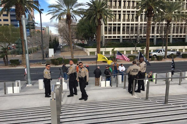 Las Vegas police watch over protesters Monday, Feb. 6, 2017, at the Lloyd George U.S. Courthouse as jury selection begins for the first trial in the case against rancher Cliven Bundy and his suppo ...