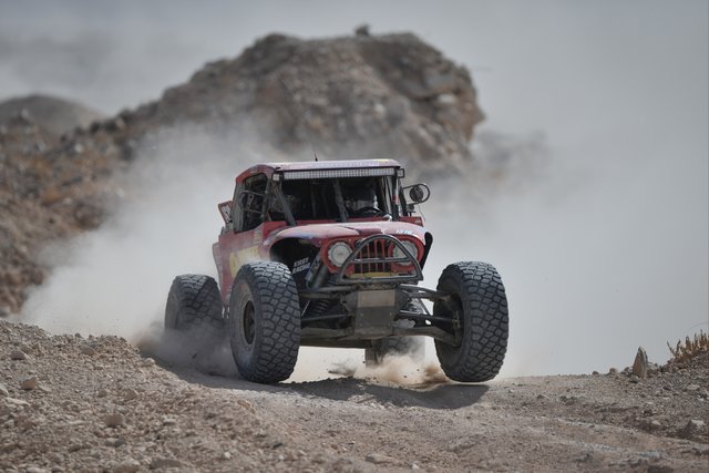 Greg Adler (1510) drives through a rock quarry on the northwest tip of the track while competing in the 1500 Pro class of the Mint 400 just east of the state line near Primm, Nev., on Saturday, Ma ...