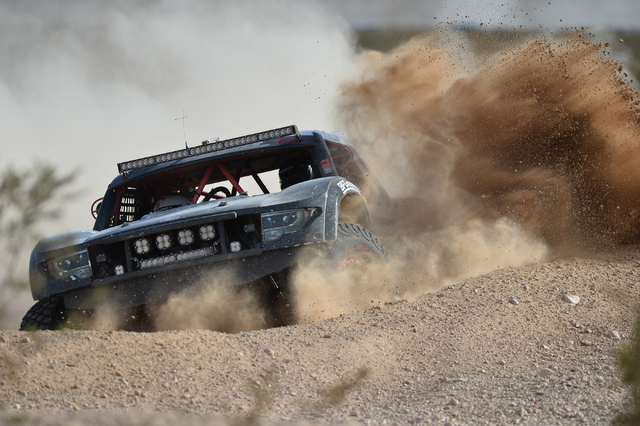 Ryan Polman (62) pilots his Trick Truck around a corner during the Mint 400 just east of the state line near Primm, Nev., on Saturday, March 12, 2016. Brett Le Blanc/Las Vegas Review-Journal Follo ...