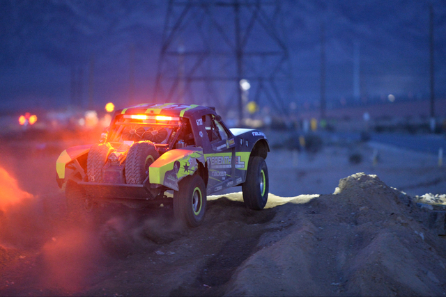 Jonathan Brenthel (6127) takes his 6100 Pro class truck over a jump during the Mint 400 just east of the state line near Primm, Nev., on Saturday, March 12, 2016. Brett Le Blanc/Las Vegas Review-J ...