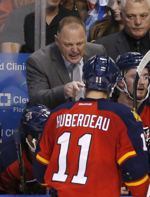 FILE - In this Feb. 15, 2016, file photo, Florida Panthers coach Gerard Gallant talks to center Jonathan Huberdeau (11) during overtime of an NHL hockey game against the Pittsburgh Penguins in Sun ...