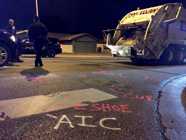 Police marking show the location of belongings of an 11-year-old girl who died after she was hit by a Republic Services garbage truck Wednesday, Feb. 8, 2017, at the corner of South Sandhill and E ...