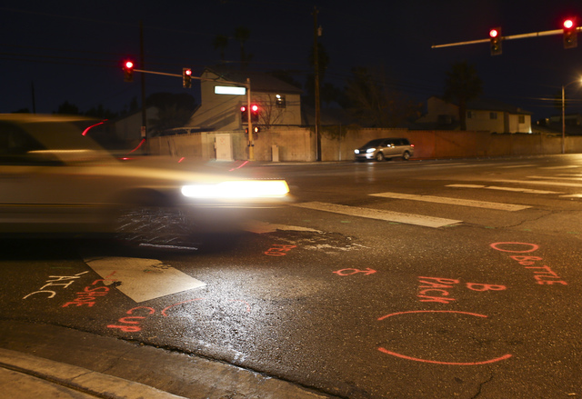 Police markings dot the intersection where an 11-year-old girl was killed by a Republic Services garbage truck at Viking and Sandhill roads in Las Vegas on Wednesday, Feb. 8, 2017. (Chase Stevens/ ...