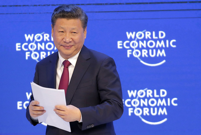 China's President Xi Jinping smiles to the audience after his speech at the World Economic Forum in Davos, Switzerland, in January. (AP Photo/Michel Euler)