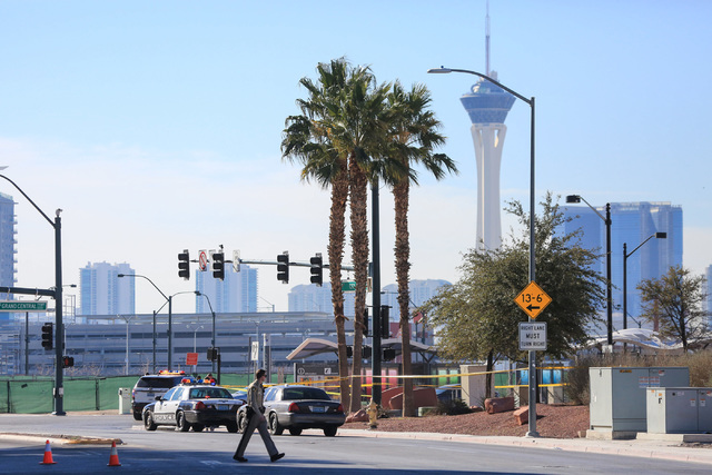 Las Vegas police investigate a body that was found by a passerby at the intersection of City Parkway and Grand Central Parkway near downtown on Friday, Feb. 3, 2017. (Brett Le Blanc/Las Vegas Revi ...