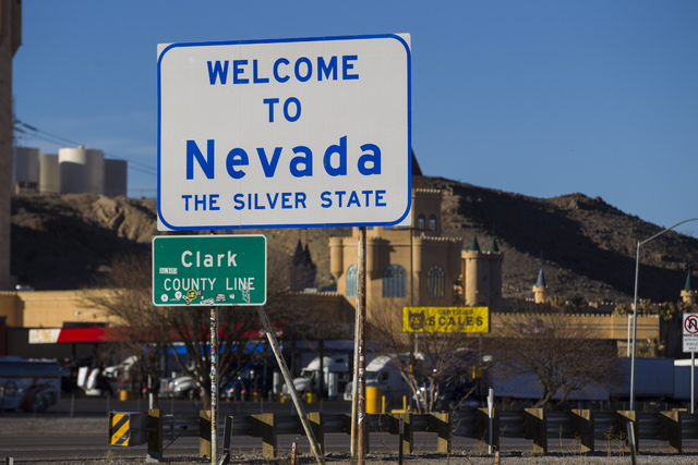 Signs mark the Clark County line and welcome travelers along Interstate 15 to the state of Nevada in Primm on Wednesday, Feb. 15, 2017. Chase Stevens/Las Vegas Review-Journal) @csstevensphoto