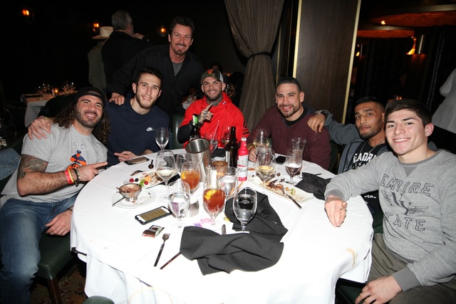 Clay Guida, Cody Garbrandt, Danny Castillo, Richard Wilk, standing, and guests at Joe Vicari's Andiamo Italian Steakhouse at The D Las Vegas. (Courtesy)