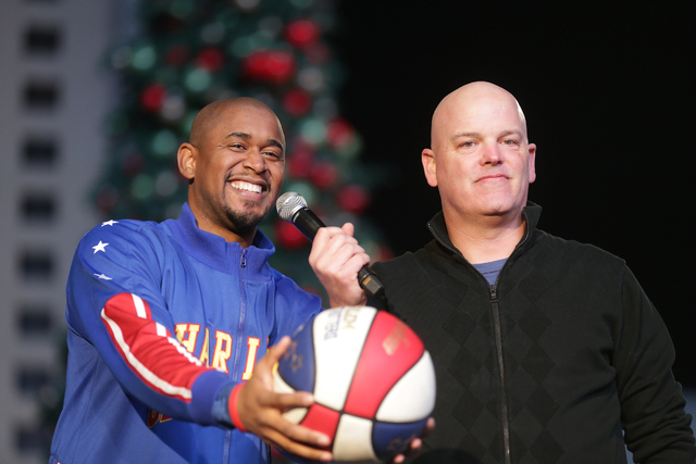 Scooter Christensen of the Harlem Globetrotters laughs with radio personality Chet Buchanan on Monday, Nov. 21, 2016, at the tree lighting ceremony at The Park in Las Vegas. (Rachel Aston/Las Vega ...