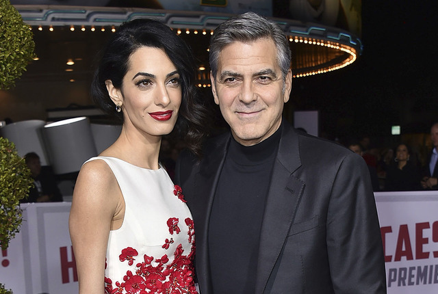 """Amal Clooney, left, and George Clooney arrive at the world premiere of """"Hail, Caesar!"""" in Los Angeles in 2016. (Photo by Jordan Strauss/Invision/AP)"""