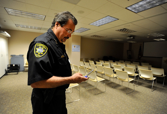 Las Vegas Township Constable John Bonaventura checks his phone in his downtown Las Vegas office on Tuesday, May 27, 2014. The Clark County Commission voted to abolish the constable's office, effec ...
