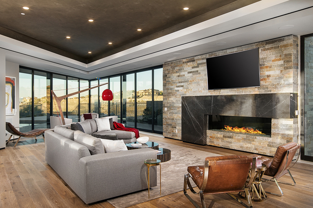 One of the home's two living rooms showcases a modern fireplace. (Courtesy)