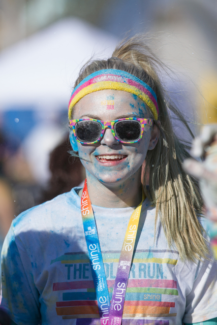 2015 Color Run participant Faith Harris is all smiles after finishing the 5k Color Run course near Fremont Street in downtown Las Vegas, Nev., Saturday, Feb. 28, 2015. (Donavon Lockett/Las Vegas R ...