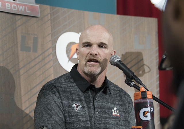Atlanta Falcons head coach Dan Quinn answers questions from media at Super Bowl LI Opening Night at Minute Maid Park in Houston, Texas, on Jan. 30, 2017. (Heidi Fang/Las Vegas Review-Journal) @Hei ...