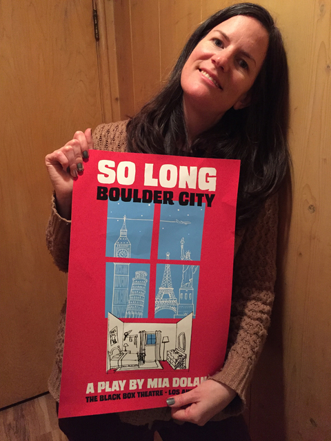 "Kim Richey holds one of the posters for ""So Long, Boulder City,"" the play Emma Stone's character writes in ""La La Land."" (Courtesy Kim Richey)"