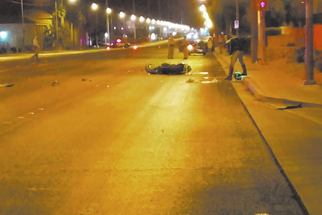 Las Vegas police investigate a crash where a motorcyclist died Nov. 21, 2016. The motorcyclist was suspected of having raced a white Chevrolet Corvette on eastbound Sahara before crashing into the ...
