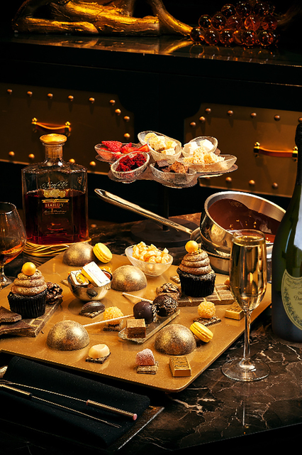 A gold-coated dark chocolate truffle is melted tableside into which you can dip an assortment of gold-dusted gummy bears, gold-dusted chocolate bars, gold-leaf cupcakes and more. (Courtesy)
