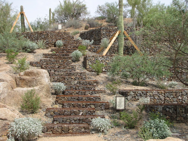 COURTESY HILFIKER RETAINING WALLS Hilfiker Retaining Walls constructed these gabion steps in Troon North Park in Arizona.