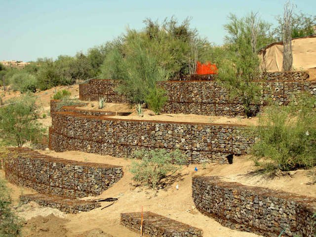 COURTESY HILFIKER RETAINING WALLS Hilfiker Retaining Walls constructed these gabion retaining walls in Troon North Park in Arizona.