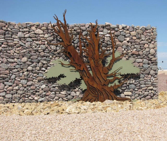COURTESY HILFIKER RETAINING WALLS This decorative gabion wall is located near a highway exit ramp in Las Vegas.