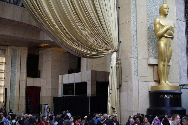 An Oscar statue is pictured outside the Dolby theater during preparations leading up to the Academy Awards in Hollywood, California. (Mario Anzuoni/Reuters)