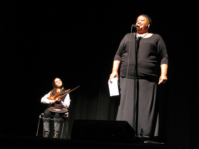 Fiddler Brigid Reedy listens to host and storyteller Dame Wilburn introducing Storytellers from The Moth n Feb. 4, 2017. It was the first time the national storytelling organization has come to th ...